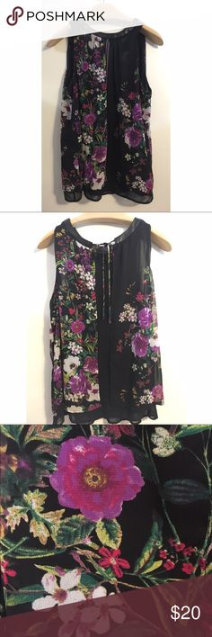 Bisou Bisou black, floral top. Size medium Bisou Bisou black, floral top. Michele Bohbot. Size medium. Ties in the back. About three small pinhole snags as pictured above in the trim but barely noticeable. Otherwise, in good condition! Bisou Bisou Tops Blouses