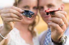 Love this photo by Amelia Soper Photography of her couple holding vintage airplane toys-symbolizing their early long-distance relationship and Tyler's job at Boeing it was a no-brainer that this wedding would give a nod to aviation. And it blended seamlessly with Lindsay's lovely vintage theme. Read more at my wedding.com
