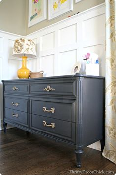 A painted black dresser with brass hardware. (Graphite by Benjamin Moore.)