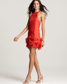 Love the rosette hem. And the coral color.