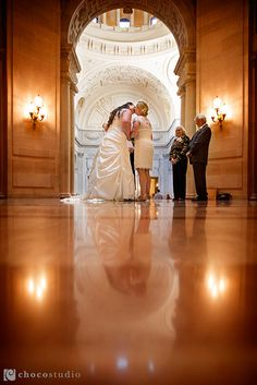 First kiss at intimate same sex City Hall wedding by Choco Studio