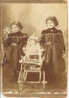 Two Girls, a Doll, and a Doll Carriage