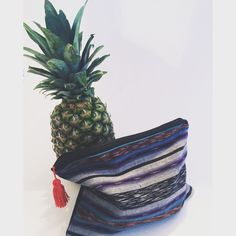 Hand sewn bohemian zipper clutch. Black and Purple fabric with a black canvas backing. Fully lined with black on the inside. Perfect clutch for a day or night out, can be used as a travel bag, makeup bag, or a bikini bag for the beach!  Dimensions: 7.5x 9.5 approximately ** Due to variations in the fabric, each and every clutch is a one of a kind unique product.