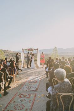DIY Joshua Tree wedding | Real Weddings and Parties | 100 Layer Cake -- Lovely alter with rugs
