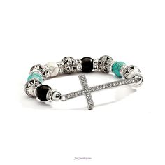 Just Jewelry: This I Know stretch bracelet with rhinestone sideways cross and colors of turquoise,  black, silver and cream