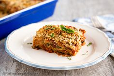 """Lightly breaded eggplant is smothered between layers of vegan cheese sauce and tomato sauce. A light cashew """"parmesan"""" adds flavor. Gluten-free and soy-free as well as low-fat. Plant Based Recipes, Veggie Recipes, Whole Food Recipes, Cooking Recipes, Kitchen Recipes, Vegan Dinner Recipes, Vegan Dinners, Vegan Vegetarian, Vegetarian Recipes"""