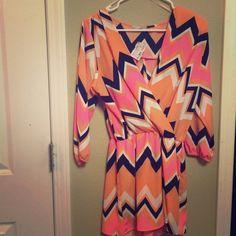 Brand new chevron romper! Never worn, size M. Spring/Summer romper! Dresses