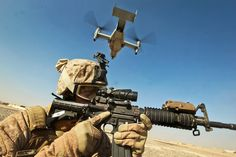 Cpl. William Cox, an armorer at the Joint Sustainment Academy Southwest, and a native of Amory, Miss., provides security as an MV-22 Osprey lands in Zaranj, Nimroz province, Dec. 30.  (U.S. Marine Corps photo by Cpl. Bryan Nygaard)