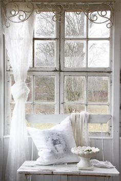 love the top metal trim to these lace curtains
