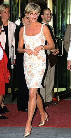 1997 Her figure-hugging Catherine Walker dress and Jimmy Choo shoes accented her long legs.