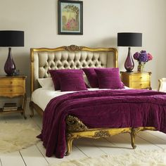 Gorgeous headboard, bed frame and rich purple accents.