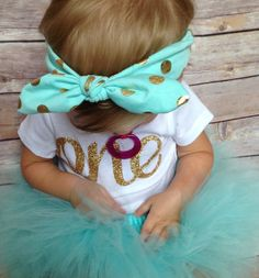 This beautiful outfit is perfect for your little girls birthday! The Aqua and gold blend well together and it puts a unique twist on the popular pink