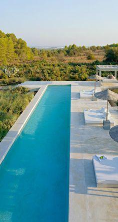 Contemporary lap pool Blue tile light paver