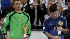 Little consolation: Messi looked less than thrilled with his Golden Ball award.