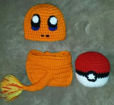 Crochet Pokémon Charmander  inspired newborn photo prop set that I made.   (Hat,  diaper cover,  and pokeball plushie)  No pattern,  just made it up as I went along.