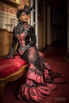 Beautiful model #theresafractale in gorgeous red and black victorian walking dress tailored by #dressartmystery.  Original historical style of the costume is combined with exotical beauty of the model. Difficult handmade fabric flowers and laces complete the look.  #historicaldress #victorianstyle #victorianfashion
