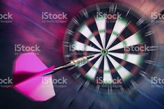 Dart about to hit target with dramatic lighting royalty-free stock photo