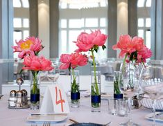 Clustered Peonies: While peonies are one of the most expensive flowers money can buy, there are ways to use them sparingly so as not to run over the flower budget, like this display of single stem vases.