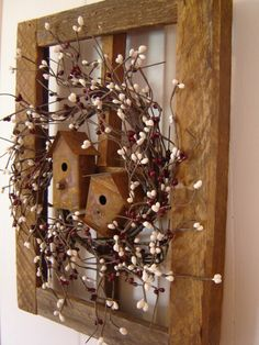 Tobacco Lath Window With Burgundy And White Berry Wreath And Birdhouses