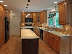 Small Kitchen Lighting Fixture Ideas - restrain oak cabinet to refresh