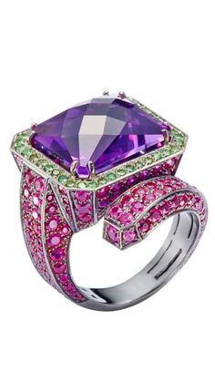 """MATTIOLI - """"Vernissage"""" Amethyst Ring. This gorgeous cocktail ring features a emerald-cut Amethyst set on an curling band of pavé Pink Sapphires. Punchy contrast and exuberant form wrap the finger in an unforgettable flourish of color and brilliance. Amethyst Weight: 13.50 carats - Pink Sapphire Total Weight: 4.15 carats - Tsavorite Total Weight: 0.40 carat - Orange Sapphire Total Weight: 0.20 carat. •US $7,630."""