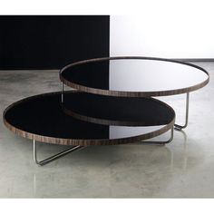 Luxo Adelphi Coffee Table - Modloft Adelphi coffee table features carbon steel frame with round top. Top available in either all leather or wood/lacquer combination. Ideally paired with model to form a multilevel table combination.