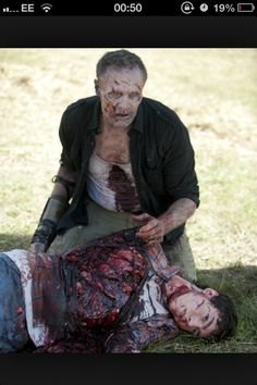 Gory zombie eating seen this some awesome special effects makeup on his face and neck