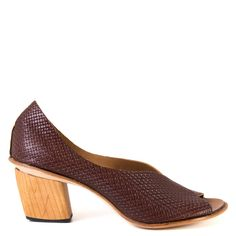 These Cydwoq Town pumps use simple style to sumptuous effect and are exclusive to buloshoes.com. The hand carved wooden heel is a fresh take on retro style and the rich chocolate brown stamped Italian leather looks beautiful on every skin tone. Wear yours with a chambray dress for a timeless look that's ready for the sunshine!  FREE Shipping in the contiguous USA Women's peep toe pump Handmade in California, USA Hand crafted vegetable- tanned leather upper with woven design Leather up...