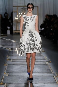 Jason Wu. I think Reese Witherspoon wore this to an award ceremony but even if not its LOVELY!