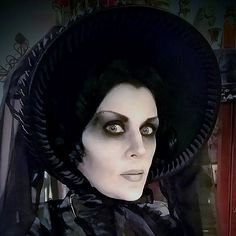 Queenie Black posing in Gothic Victorian bonnet and deathly pale makeup