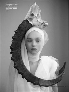 Russian fashion photo shoot -- and that child is too young to be presented as an adult female #bw