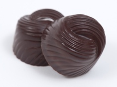 I'm Nuts for Coco... A swirl of 72% dark chocolate made from Venezuelan cacao surrounds a delicious creamy Ivoire chocolate ganache of roasted coconut. Get some in the Lisa Luxx collection $29.00http://luxxchocolat.com/luxxboxof12.aspx  Repin if you want some...