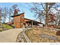 MLS 2119938, 5 beds, 5 baths - Exceptional equestrian facility with an amazing rustic style home-yet all the luxuries you would expect! Almost 50 acres of serenity. Huge rocking chair front porch, 2 story great room, wood floors, slate floors, granite counter tops. Unique features throughout. 2 sided fireplace, spiral staircase to master closet., built-in beds, double decks off the rear of the home. Truly an exquisite estate!