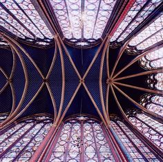 Look at the stained glass windows and the rich colour of the vaulted ceiling.....beautiful.