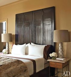 Brilliant use of a room divider as the headboard.  Simple yet sophisticated.