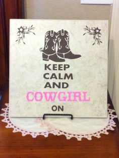 12X12 neutral color ceramic tile with chocolate brown and pink vinyl decal with pink jewels.  Keep Calm and Cowgirl On on Etsy, $25.00