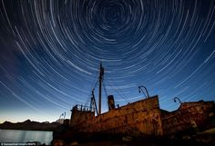 Stunning: These star trails were captured above the wrecks of two Norwegian whaling boats in South Georgia