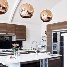 copper pendants, wood cabinets, white countertop, kitchen