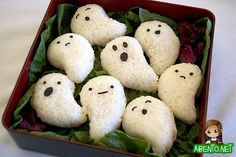 It's time for me to turn on the spooky bentos and I start off with some ghostly onigiri and some disgusting hot dog fingers.