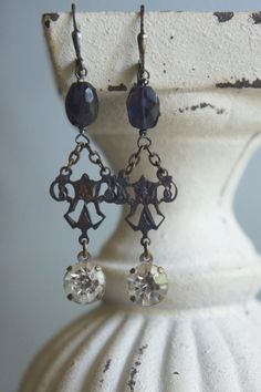 """Aged bronzed, ornate jewelry connectors hang from faceted oval iolite gemstone beads that dangle large rhinestone drops from an old necklace. Length: 1 3/4"""" from bottom of ear wires —by French Feather Designs"""