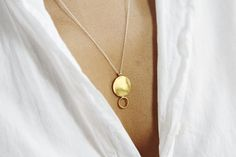 Limited edition gold-plated brass pendant on a sterling silver chain, sourced in America.