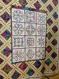 Celtic block designs by Philomena Durcan set into a patchwork quilt. Picture from Flickr.