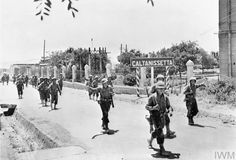 Drive for Messina 10July-17Aug1943:Cheerful GIs leave town of Caltanissetta which they captured on 18July during their advance on Palermo.