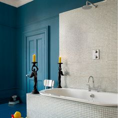 green tiled shower - marks it as separate area in bathroom. love ...