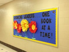 Growing Leaders. . .One Book at a Time! Bulletin Board Leader in Me South Green Elementary Library; Paper plate and tissue paper flowers with stems sprouting from open books