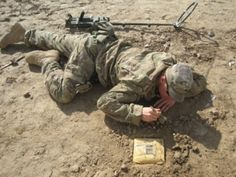 Sgt. Brody Staman, 24, from Scotts Bluff, Neb., finishes clearing the dirt around a pressure-plate IED during a drill on Feb. 11, 2012. The Vallon metal detector he uses to search for IEDs is behind him. (Copyright 2012 Cheryl Hatch --  http://north2thefuture.wordpress.com/)