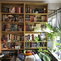 Bookwall in the livingroom by Nini Tjäder