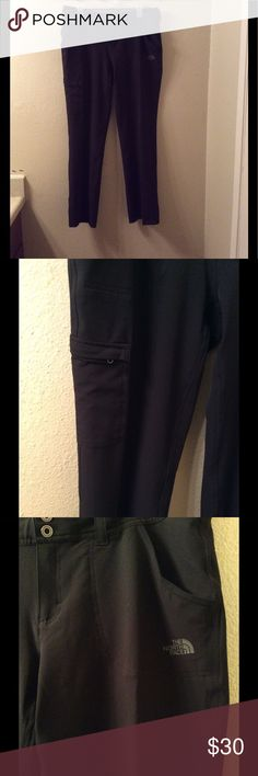 """Women's the north face black outdoor pants Sz 10 Excellent like new condition black pants. Perfect for hiking, walking or any outdoor activity. They have stretch all over. They have a Button and also a drawstring on the waist. Waist across measures 17"""" the inseam is 31"""" and length is 41"""" The North Face Pants"""