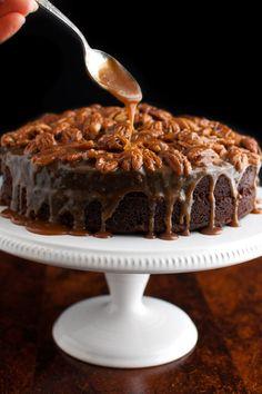 Salted Caramel and Pecan Chocolate Cake - a devil's food cake filled with salted caramel and topped with toasted salted pecans and more caramel sauce. | tamingofthespoon.com