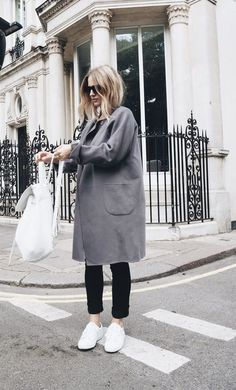 gray coat, white shoes.
